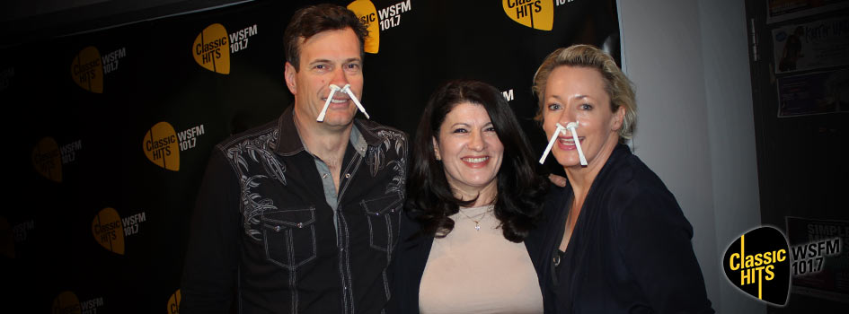 WSFM Radio Hosts Jonesy and Amanda with Nad's Nose Wax in their nostrils standing with Sue Ismiel