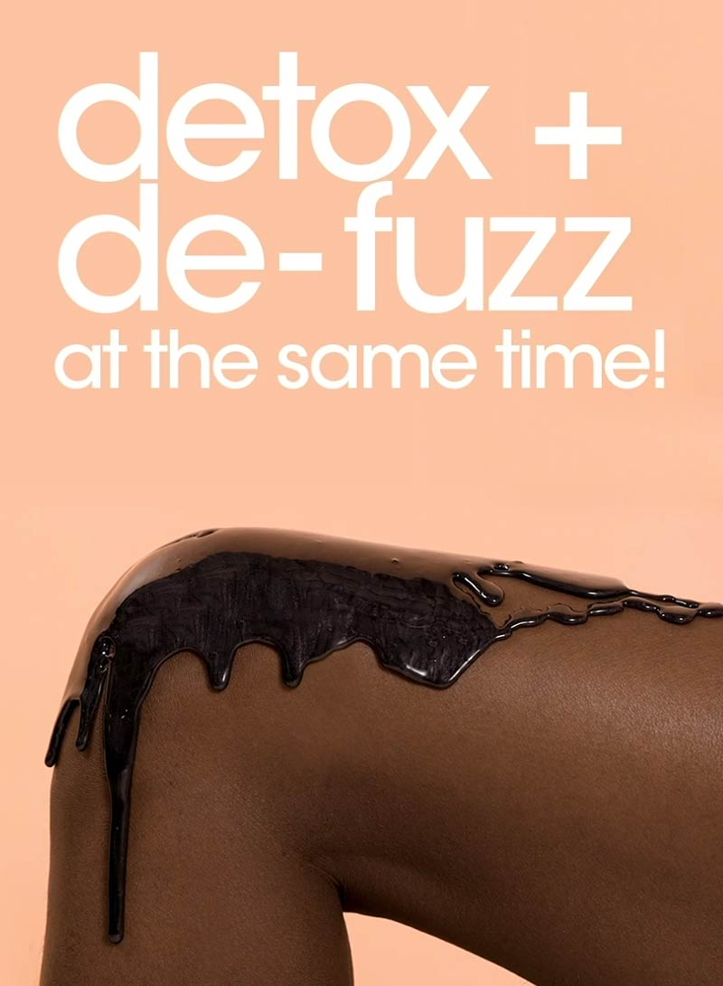 Charcoal wax dripping down woman's knee next to text Detox + De-Fuzz At The Same Time!