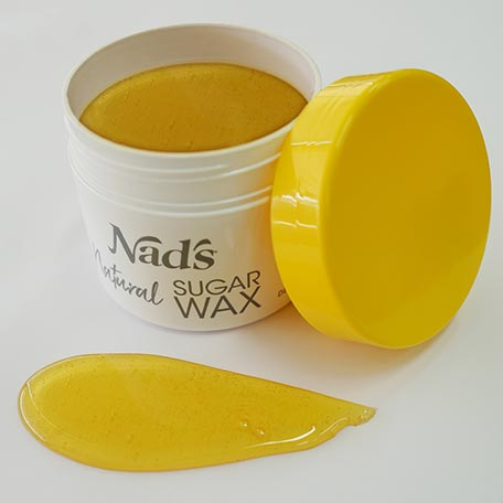 Nad's Natural Sugar Wax open container with wax poured out