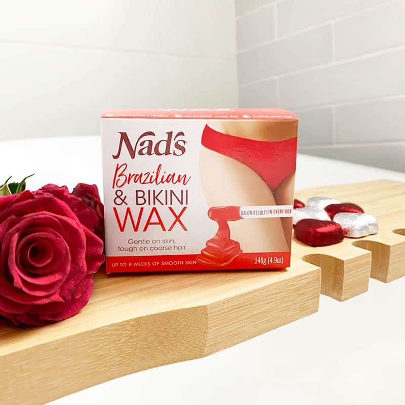 Nad's Brazilian and Bikini Wax product on bathroom counter next to roses and chocolates